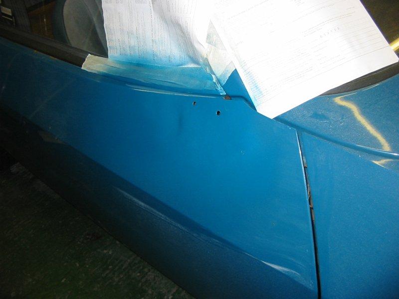 Capri door with new holes for bullet mirror