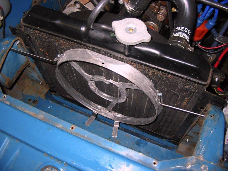 Trial fitting the Escort radiator fan in the Capri engine bay